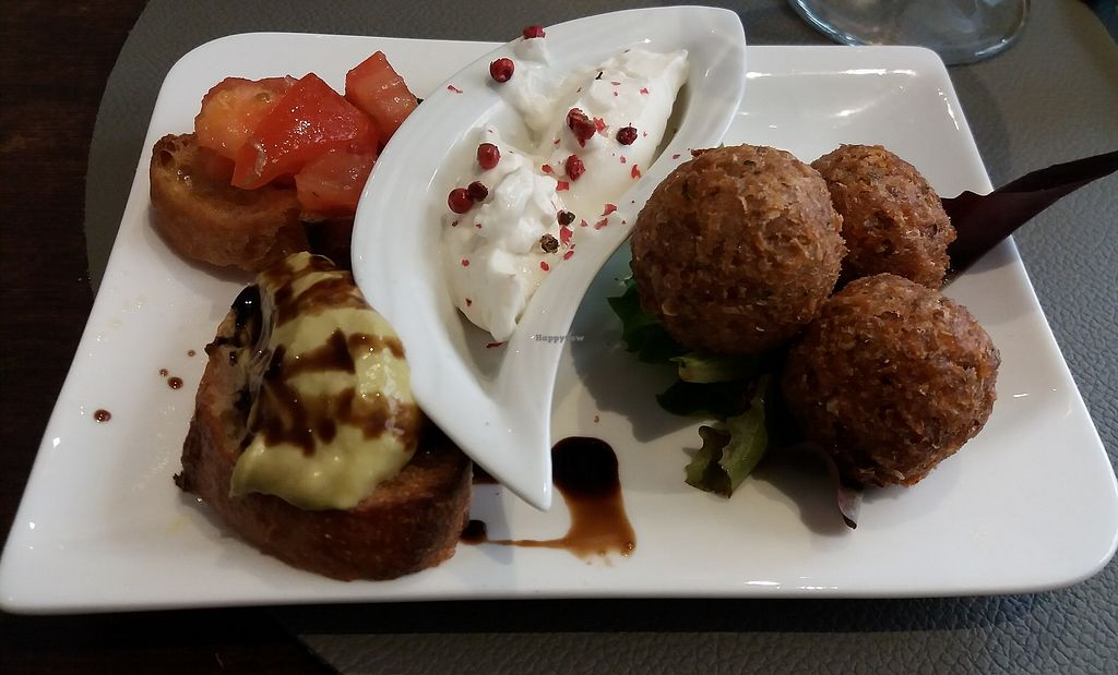"A welcome surprise: an amuse bouche of mini toasts and ""accras,"" deep fried balls of goodness with a creamy dipping sauce. at Utopia in Nice"