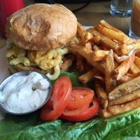 Veggie burger topped with mac n cheez, spicy fries on side.   at Vertical Diner in Salt Lake City