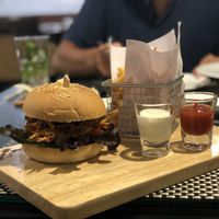 Mon Jam Burger- *Ordered without cheese to make it vegan. *The white sauce is vegan. Fried mushrooms with the normal burger veggies in. Very tasty wish it came with a sauce. Good. at Moreganic Restaurant in Chiang Mai