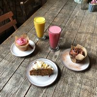 Beetroot latte, tumeric latte, vegan chocolate muffin, vegan raspberry muffin, vegan carrot and coconut cake at West Six Garden Cafe in West London