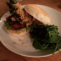 Tempeh burger: smoky tempeh steaks with beetroot relish and seasonal veg fritter at Curly Kale Cafe in Cambridge