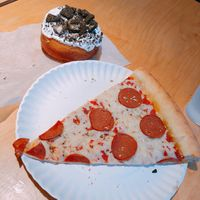 """""""Pepperoni"""" pizza and a cookies n cream donut at Apiecalypse Now Pizza and Snack Bar in Toronto"""