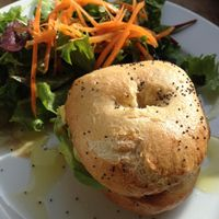 Sunday brunch special - fresh, locally-baked bagel with red pepper hummus, avocado, sun-dried tomato; and delicious dressing on the side salad! at Espresso Library in Cambridge