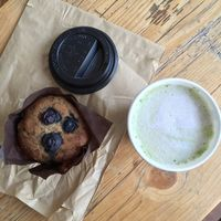Vegan GF blueberry muffin with almond matcha latte  at Roots Juicery in London