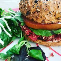 Vegan burger with cashew nut cheese sauce  at Roots Juicery in London